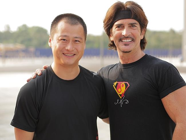Missing ... Stunt man Ju Kun, left, with John Fusco, creator of the show Marco Polo on the back lot of the new Pinewood Studios in Johor Bahru, Malaysia.