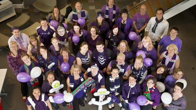 Staff from the RAC get into the purple fever for 'Wear Purple to Work Day' last year.