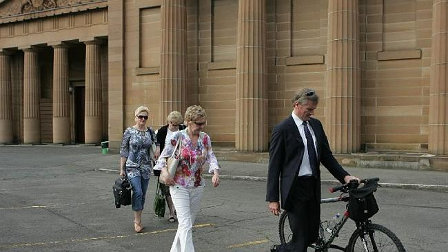 Innocent: accused girlfriend killer Gordon Wood, above with his family at Darlinghurst Supreme Court in Sydney, was convicted by a jury, then found innocent on appeal. Picture: News Limited