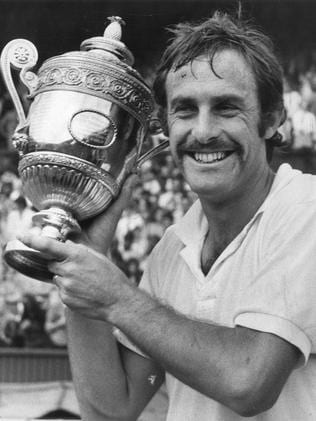 John Newcombe with one of his Wimbledon trophies.