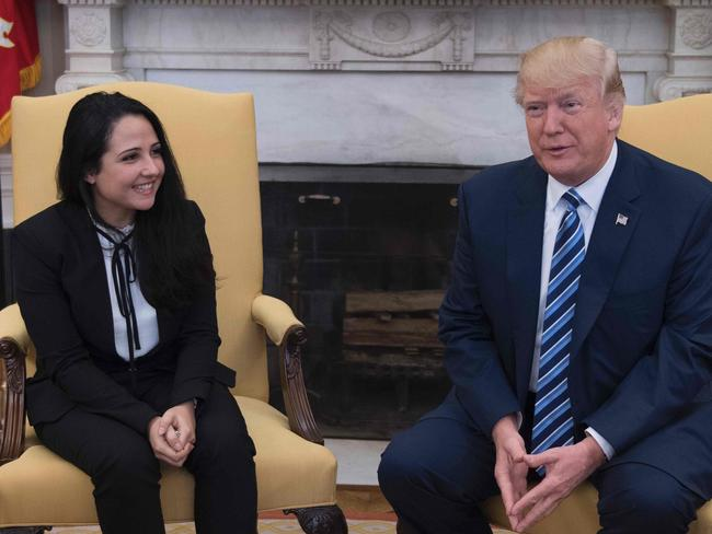 Freed aide worker Aya Hijazi with Donald Trump at the White House. Picture: AFP/Jim Watson