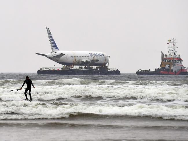 ONA paddle boarder is seen as Boeing 767 aeroplane arrives the Enniscrone estuary. Picture: Reuters
