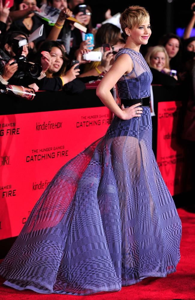 The purple Dior dress Jennifer Lawrence wore to the Cathching Fire premiere is on show as part of The House of Dior exhibition. Picture: Getty Images