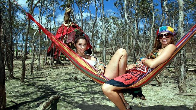Palmer River eclipse festival: Kasi Sealey and Jess Ward from the Gold Coast relax in a hammock as they await the eclipse. Picture: Tom Lee