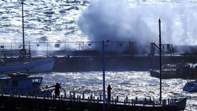 Amateur photographers capture gigantic waves crashing into Mornington Harbour. Picture: Michael Dodge/Getty Images.