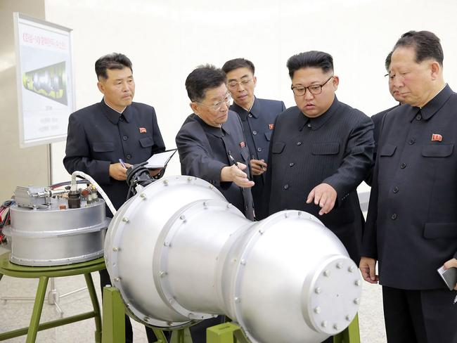 North Korean leader Kim Jong-un looking at what was said to be a model of a miniaturised nuclear warhead. North Korea's latest nuclear test was around 160 kilotons — more than ten times the size of the Hiroshima bomb. Picture: AFP / KCNA via KNS