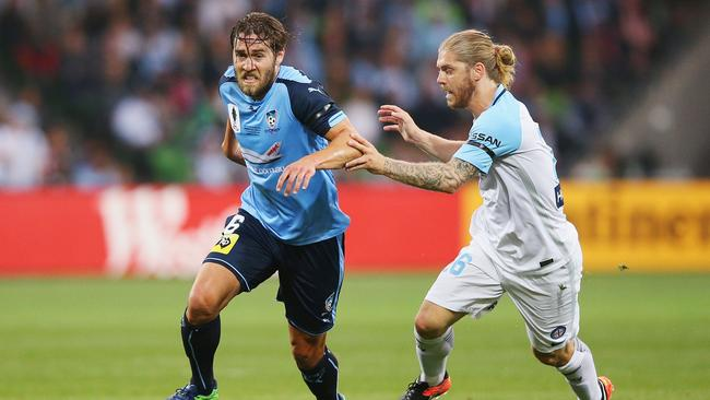 Joshua Brillante of Sydney FC runs with the ball past Luke Brattan during the FFA Cup final.
