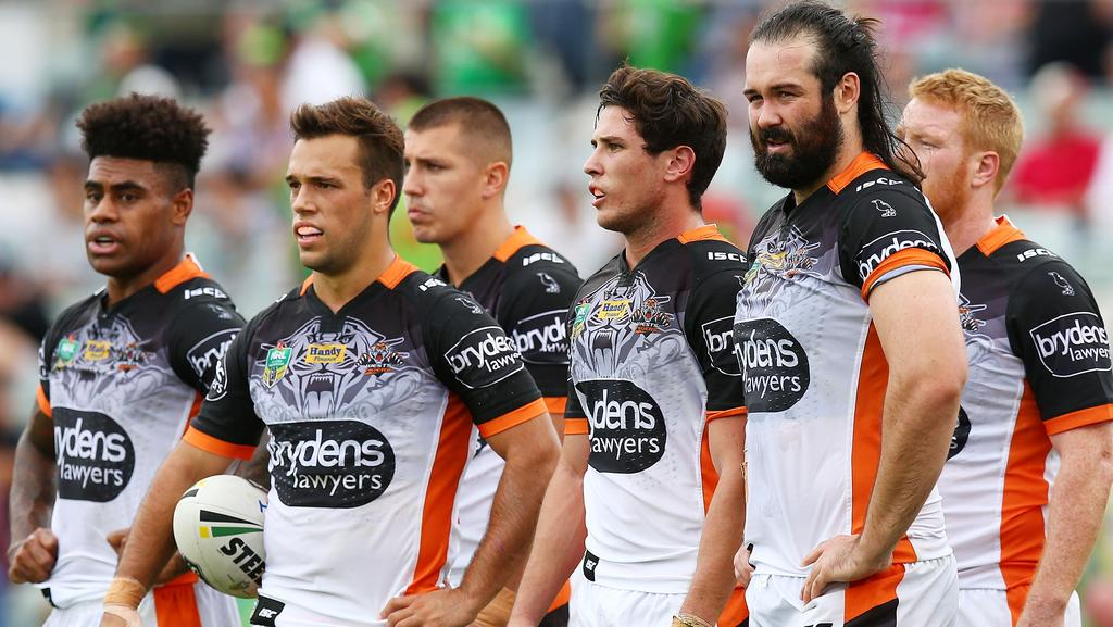 Dejected Wests Tigers players after a Raiders try.