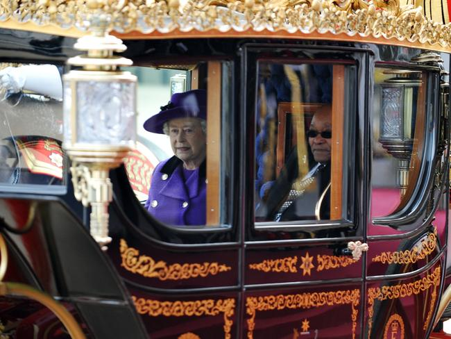 Queen Elizabeth II with South African President Jacob Zuma ride in a carriage on their way to Buckingham Palace in 2010.