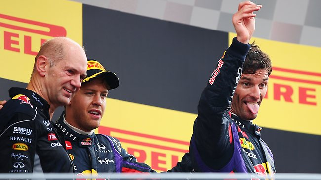 Race winner Sebastian Vettel (C) of Germany and Infiniti Red Bull Racing, third placed Mark Webber (R) of Australia and Infiniti Red Bull Racing and Infiniti Red Bull Racing Chief Technical Officer Adrian Newey (L) celebrate on the podium following the Italian Formula One Grand Prix.