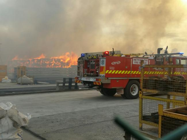 Fire crews working hard to battle a blaze at a Coolaroo recycling plant, the second time crews were called to the site in 24 hours. Picture: Supplied