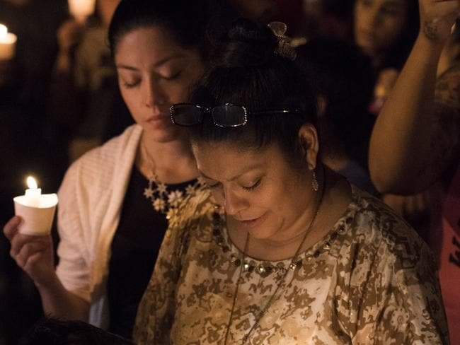 Mourners participate in a candlelight vigil held for the victims of a fatal shooting at the First Baptist Church in Sutherland Springs, Sunday, Nov. 5, 2017, in Sutherland Springs, Texas. Picture: AP.