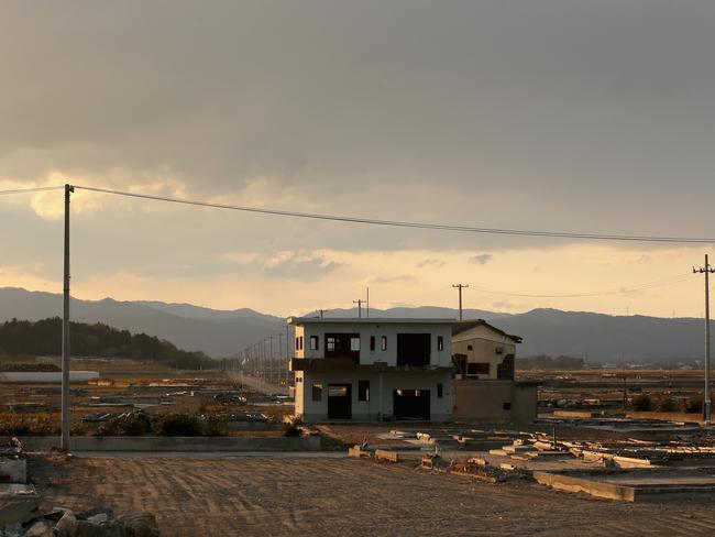 A lone house sits on the scarred landscape, inside the exclusion zone, close to the devastated Fukushima Daiichi Nuclear Power Plant. Picture: Getty