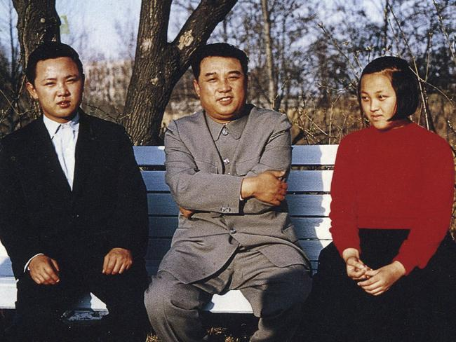 North Korean leader Kim Il-Sung flanked by his son Kim Jong-Il and daughter Kim Kyong-hui in the garden of their home capital Pyongyang in 1963.
