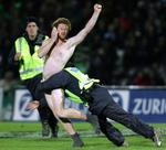 <p>A streaker talks on his mobile phone as he is tackled by security staff during the British and Irish Lions rugby tour match against Manawatu at Arena Manawatu, Palmerston North in New Zealand.</p>