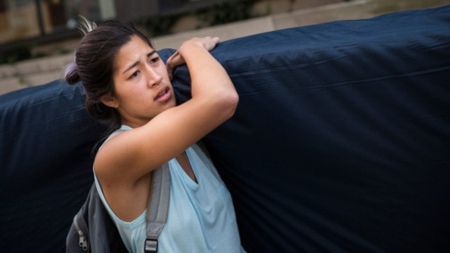 Emma Sulkowicz carries a mattress in protest against what she has called Columbia University's lack of action.