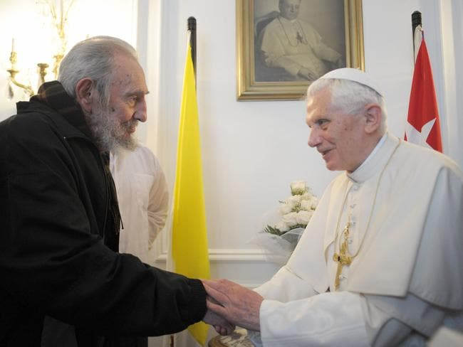 Previous pope ... Pope Benedict XVI (pictured with Fidel Castro in 2012) retired last year. Picture: AP Photo/Osservatore Romano