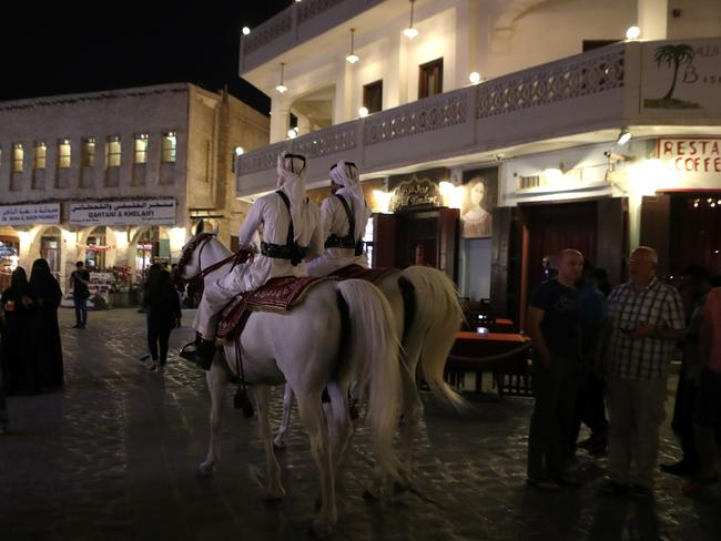Mounted police patrol the popular Souq Waqif market, in the Qatari capital, Doha, following the cut in diplomatic ties. Picture: AFP