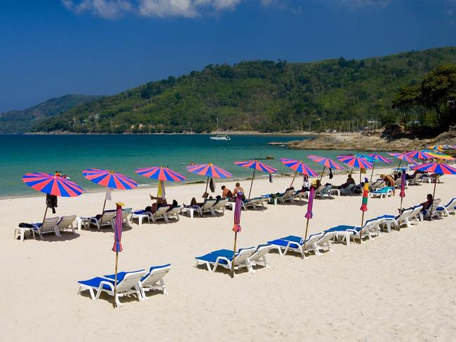 There one minute, gone the next ... Umbrellas and deckchairs on Kata Beach in Phuket, Thailand. Picture: Supplied