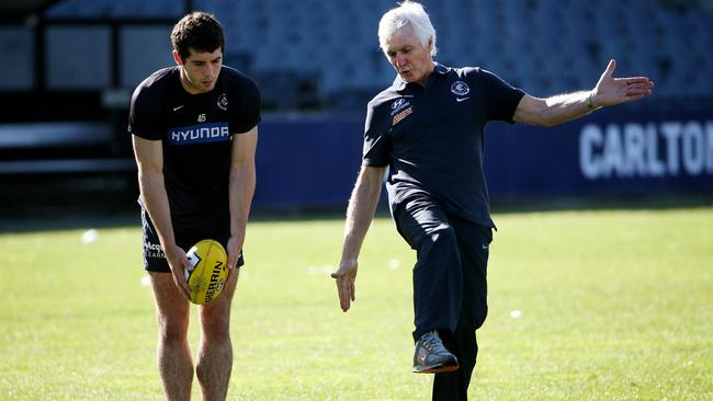 Mick Malthouse spends time with Blaine Johnson on the art of kicking. Picture: Colleen Petch