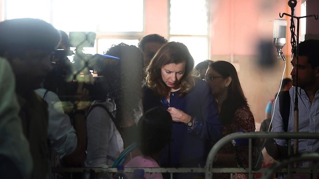 Charitable ... Valerie Trierweiler visits a patient during her visit to a hospital in Mumbai, India. Picture: AP