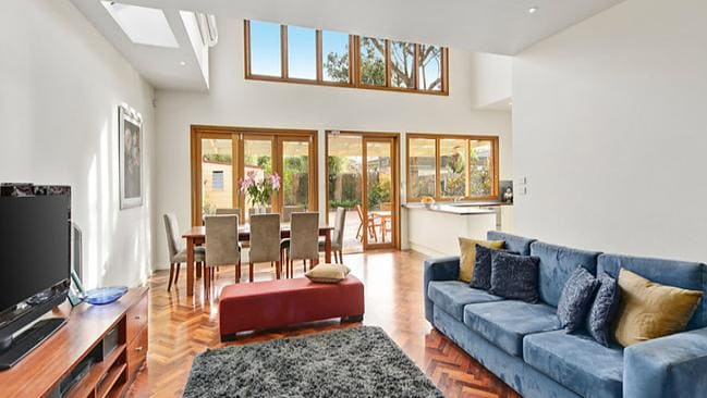 A modern family area is a highlight at 22 Gillies St, Fairfield.