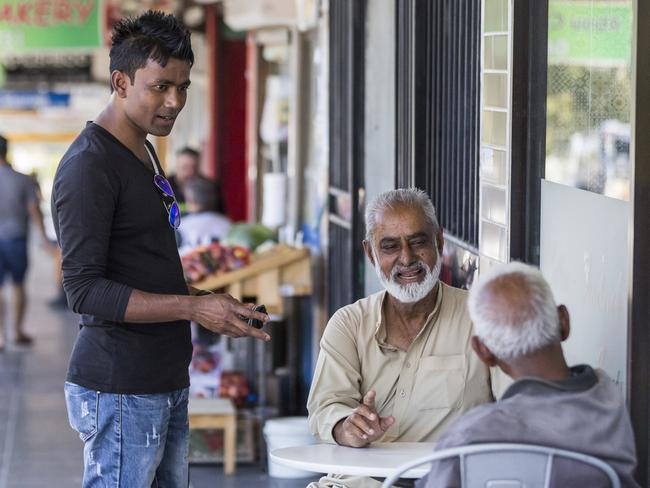 Sayed Alam, Muhammad Nazir and Michael Chinappa enjoy a chat on the streets of Lakemba, despite their different nationalities and religions. Picture: Sarah Keayes