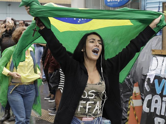 A woman waves a Brazilian national flag, celebrating the impeachment of Brazil's President Dilma Rousseff, in Sao Paulo, Brazil. Picture: AP