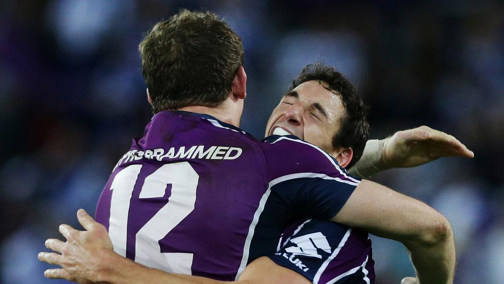 2012 NRL Grand Final between the Canterbury Bankstown Bulldogs and Melbourne Storm at ANZ Stadium, Sydney. Melbourne's Billy Slater celebrates victory with Ryan Hoffman.