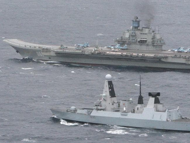The British destroyer HMS Dragon shadows the Admiral Kuznetsov in the English Channel in 2014. Picture: Ministry of Defence