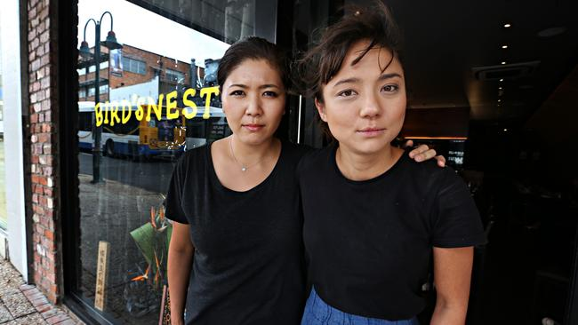 Emi Rakowski and Marie Yokoyama from the Bird's Nest restaurant in Brisbane say they have been targeted by the meal scam.