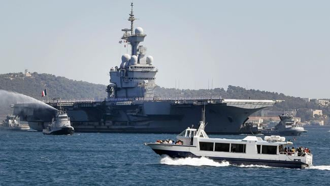 """The French Charles de Gaulle aircraft carrier earlier this month. The nation's president has pledged to """"punish"""" the Syrian regime and British warplanes have been spotted near Syria. Picture: AFP"""