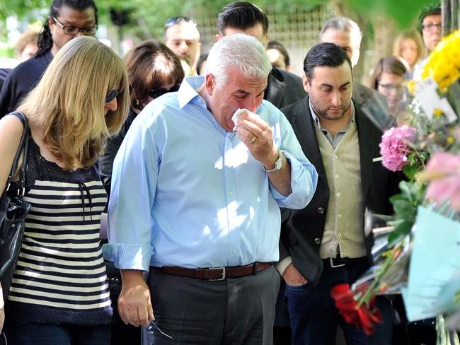 Amy Winehouse's father Mitch Winehouse and brother Alex Winehouse look at floral tributes for Amy.