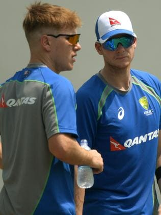 Australian captain Steven Smith (R) speaks with teammate Adam Zampa during a training session at the Vidarbha Cricket Association Stadium in Nagpur on September 30, 2017. Australia will play the fifth one-day international cricket match against India on October 1 in Nagpur. / AFP PHOTO / PUNIT PARANJPE / ----IMAGE RESTRICTED TO EDITORIAL USE - STRICTLY NO COMMERCIAL USE----- / GETTYOUT