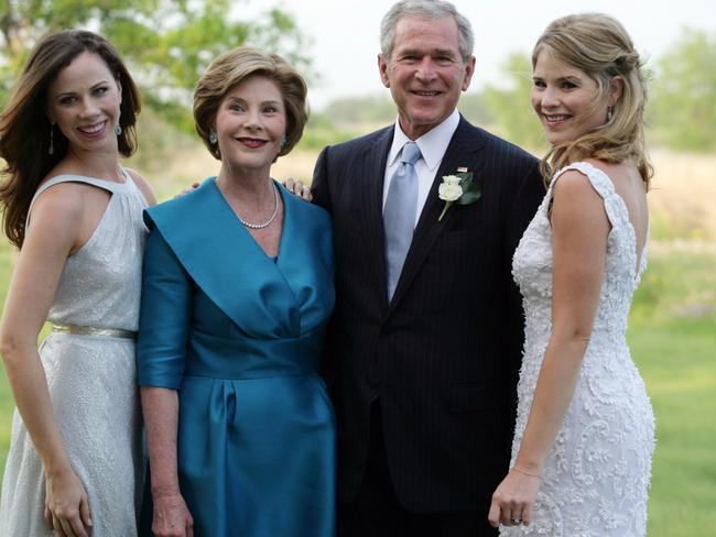 Twin trouble ... Former US Presdient George W. Bush and Mrs Laura Bush posing with daughters Jenna (right) and Barbara (left). Picture: AFP