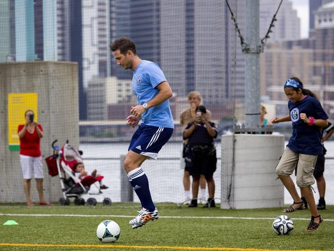 Frank Lampard participates in a clinic with young players after he was introduced as a member of the MLS expansion club New York City FC.