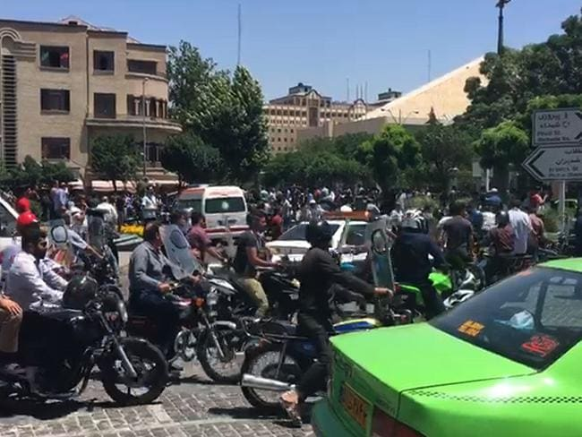 An image grab taken from AFPTV shows the scene outside Iranian parliament in the capital Tehran during an attack on the complex. Picture: AFP / AFPTV / Majid SOURATI