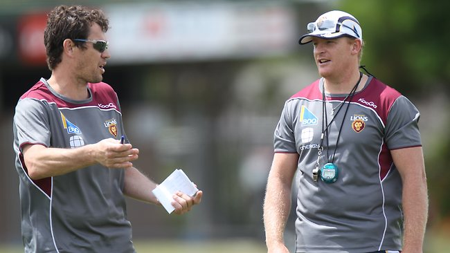 Brisbane Lions assistant coach Mark Harvey with Michael Voss at training. Picture: David Kapernick