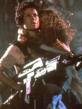 Ripley and Newt prepare to scare off the Alien Queen.