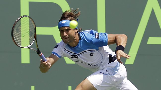 David Ferrer makes a running shot in his win over Kei Nishikori, of Japan at the Miami Masters. Picture: Alan Diaz