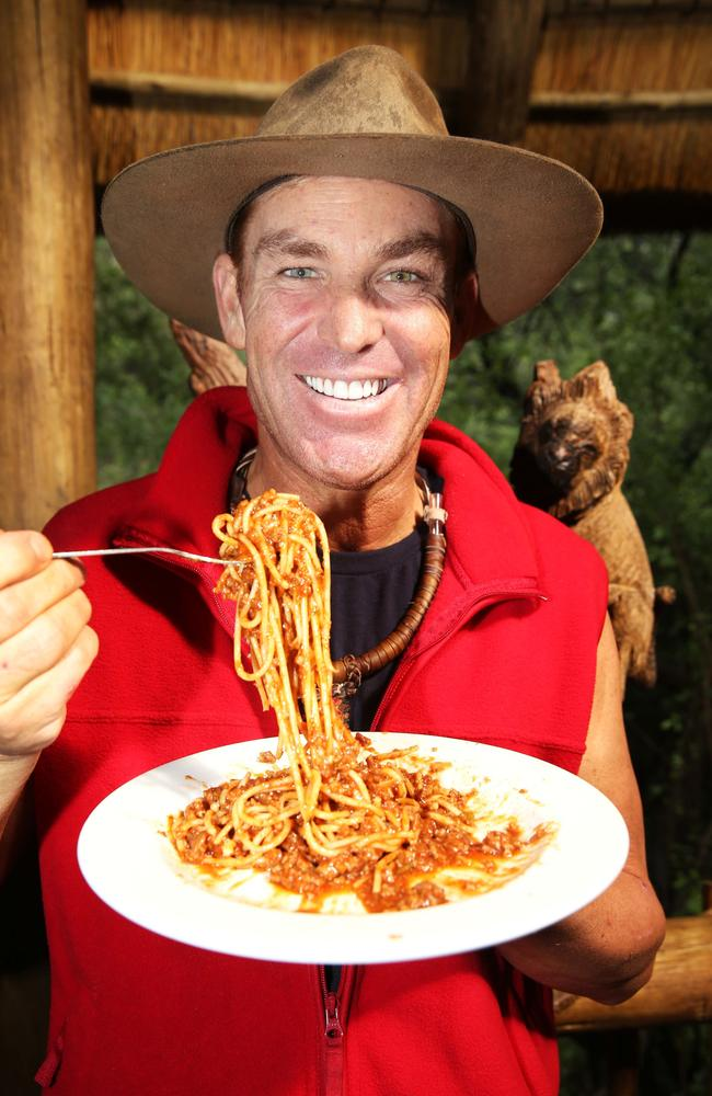 Shane Warne tucks into some spaghetti after leaving the jungle. Picture: Nigel Wright/Ten Network