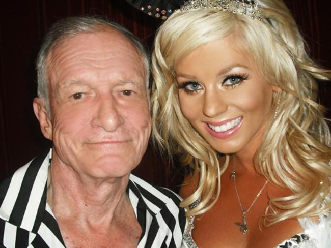 Hugh Hefner told a twitter user how to treat women.