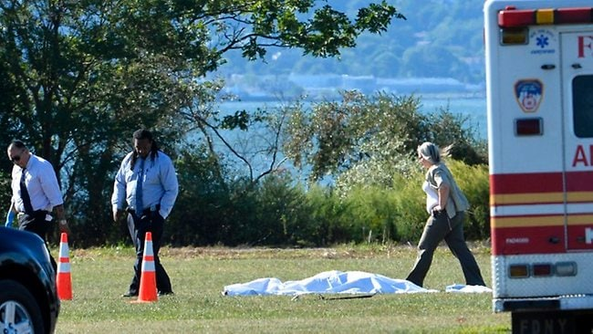The body of a 19-year-old man lies in the park where he was decapitated by a toy helicopter. (Photo: Paul Martinka)