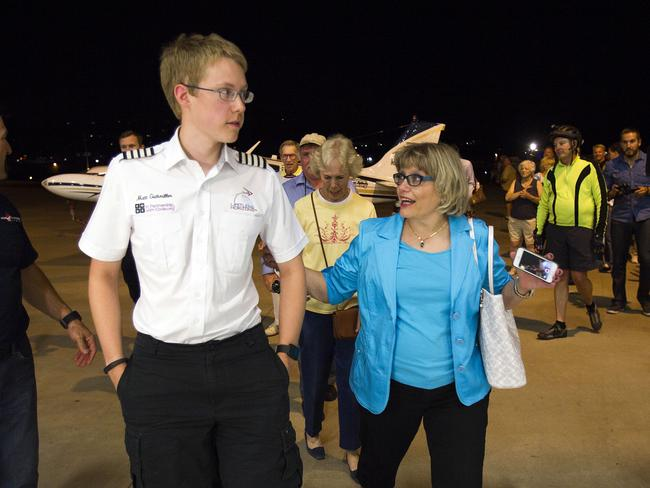 Proud mum ... Matt Guthmiller, right, the youngest pilot to fly solo around the world, walks with his mother Shirley after arriving at Gillespie Field in El Cajon. Picture: AP