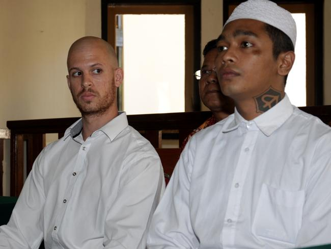 Behind bars ... Nicholas Langan with his friend Hanung Hermantoro in Denpasar District Court