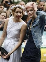 Peaches Geldof, left, talks to her sister Pixie Geldof, daughters of Bob Geldof, as they arrive for the British premiere of the film 'Bruno' in London. Picture: AP Photo/Sang Tan, File