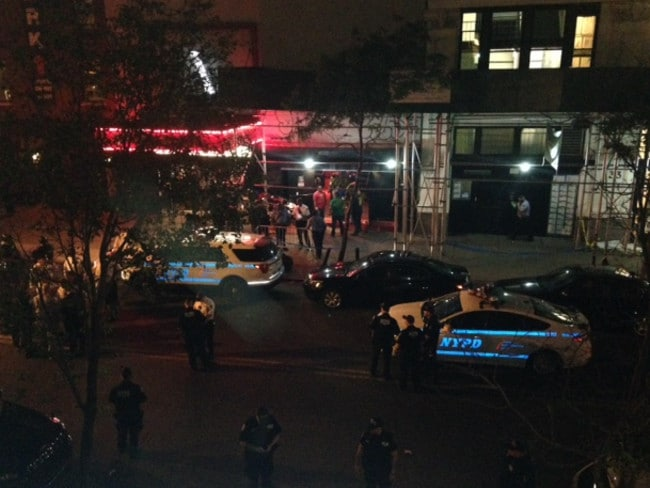 Authorities stand outside Irving Plaza, near Manhattan's Uni-on Square in New York after the shooting. Picture: AP
