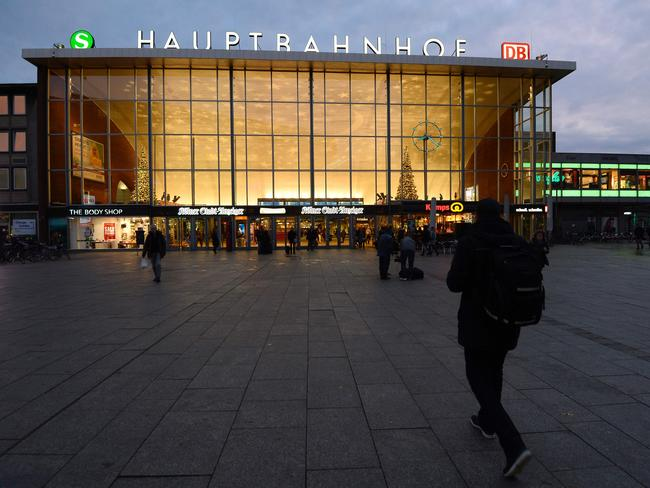 Security fears ... People walk in front of the main railway station in Cologne where apparently co-ordinated sex attacks were perpetred during New Year's Eve.