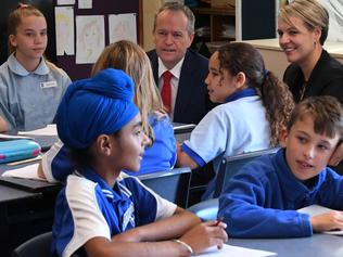 Australian Opposition Leader Bill Shorten (centre) speaks to school kids as he visits St Thomas the Apostle Primary School in Canberra, Wednesday, June 21, 2017. (AAP Image/Lukas Coch) NO ARCHIVING