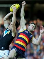 Round 15: Angus Monfries is too good for Crow Brodie Smith's attempted spoil. Picture: Simon Cross